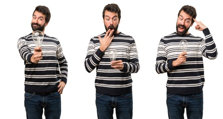 Set of Surprised Man with beard holding a bulb