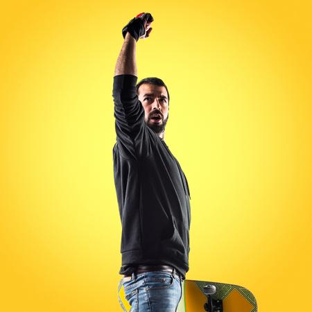 Lucky man with skateboard Stock Photo