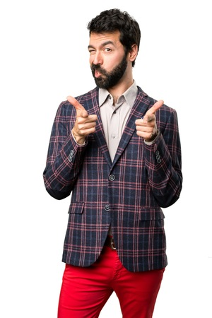 Well dressed man pointing to the front on white background