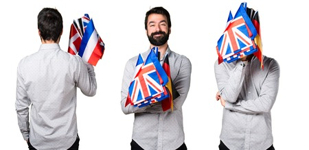 Handsome man with beard holding many flags Stock Photo