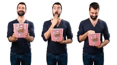 Set of Handsome man with beard eating popcorns