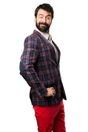 Well dressed man winking on white background Stock Photo