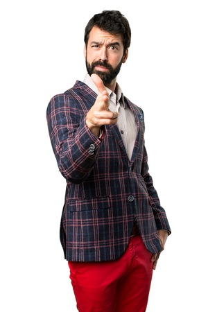 Well dressed man making gun gesture on white background Stock Photo