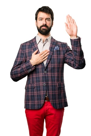 Well dressed man making an oath on white background