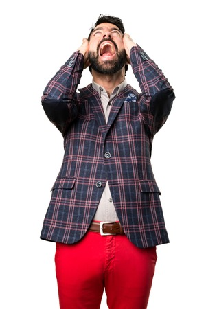 Frustrated well dressed man on white background