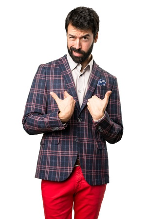Well dressed man making surprise gesture on white background