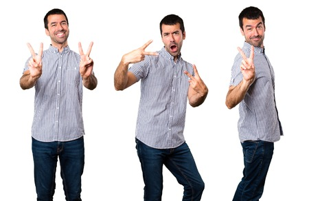 Set of Handsome man making victory gesture Stock Photo