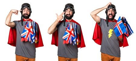 Superhero with a lot of flags making suicide gesture and frustrated Stock Photo