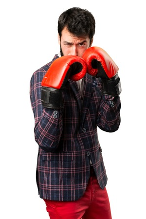 Well dressed man with boxing gloves on white background
