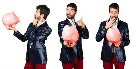 Man with jacket holding a piggybank Stock Photo