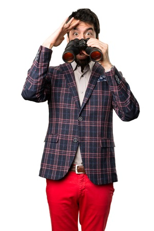 Surprised Well dressed man with binoculars on white background