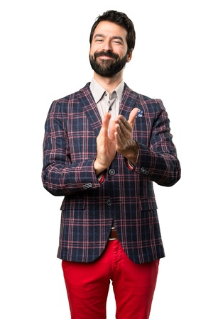 Well dressed man applauding on white background Stock Photo