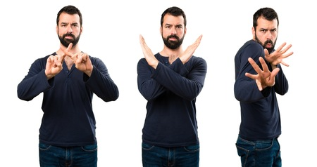 Set of Handsome man with beard making NO gesture Фото со стока