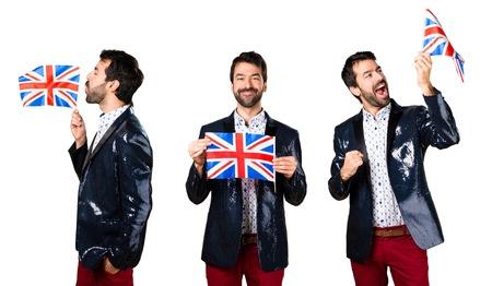 Man with jacket holding an UK flag Stock Photo
