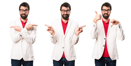 Set of Brunette man with glasses pointing to the laterals having doubts Stock Photo