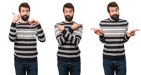 Set of Man with beard pointing to the laterals having doubts