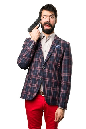 Well dressed man cometing suicide on white background