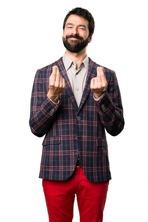 Well dressed man making money gesture on white background