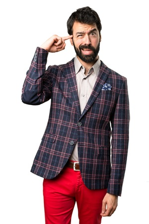 Well dressed man making crazy gesture on white background