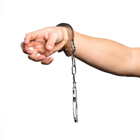 Handcuffs over isolated white background
