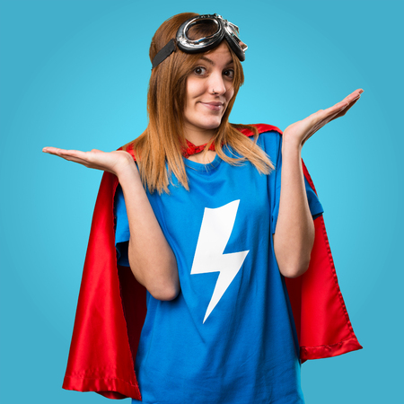 Pretty superhero girl making unimportant gesture on colorful background
