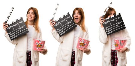 Set of Young woman in dressing gown holding a clapperboard