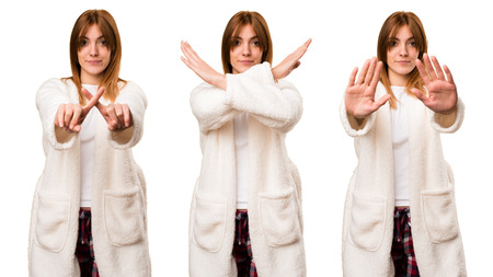 Set of Young woman in dressing gown making NO gesture