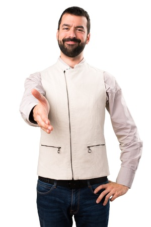 Handsome man with vest making a deal on isolated white background Banque d'images