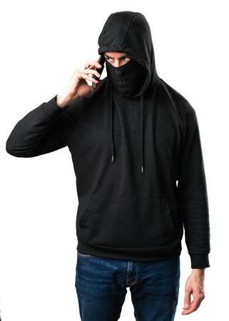 Hacker with his mobile on isolated white background