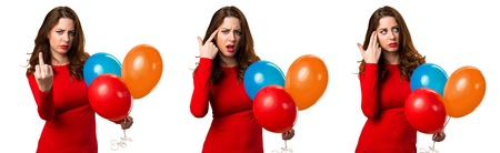 Set of Beautiful young girl holding balloons and making crazy gesture Stock Photo