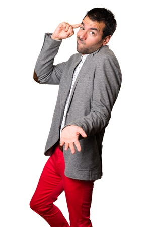 Handsome man making crazy gesture on isolated background