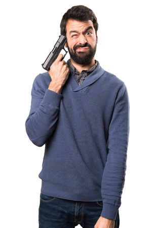 Handsome brunette man with beard cometing suicide on white background