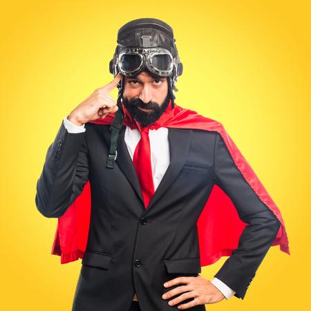 Super hero businessman thinking