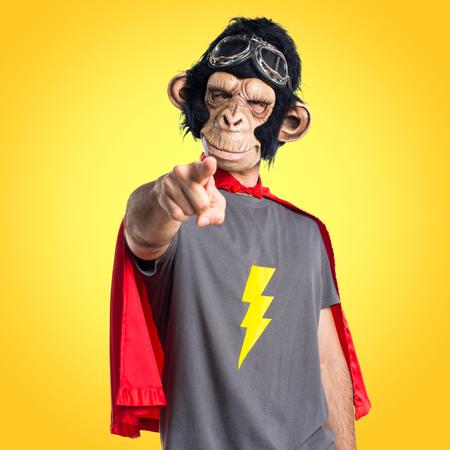 Superhero monkey man pointing to the front