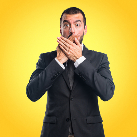 Businessman covering his mouth Stock Photo