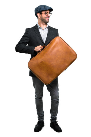 holding a vintage briefcase