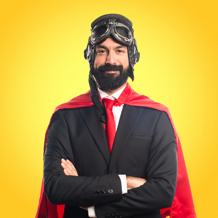 Super hero businessman with his arms crossed