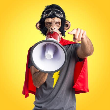 Superhero monkey man shouting by megaphone Stock Photo