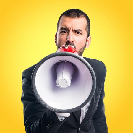 Businessman shouting by megaphone
