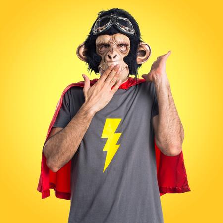 Superhero monkey man doing surprise gesture Stock Photo