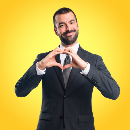 Businessman making a heart with his hands Stock Photo