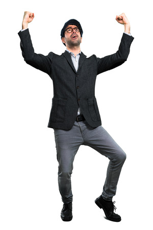 Handsome modern man with beret and glasses celebrating a victory Stock Photo