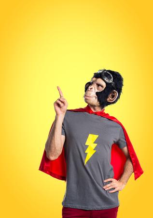 Superhero monkey man pointing up
