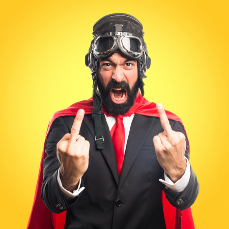 Super hero businessman making horn gesture Stock Photo