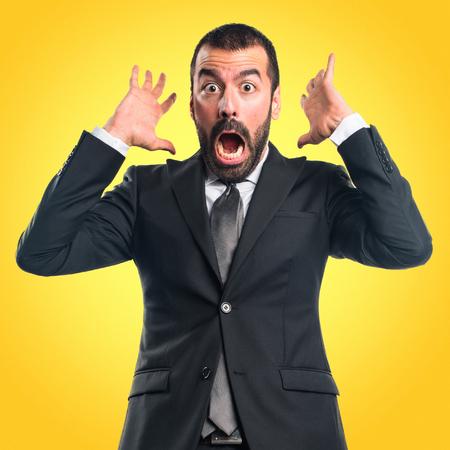 Businessman doing surprise gesture