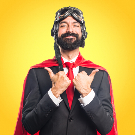 Super hero businessman with thumb up