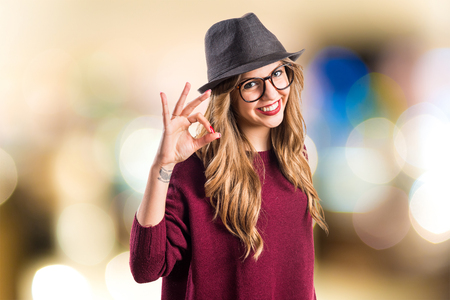 Hipster young girl making OK sign