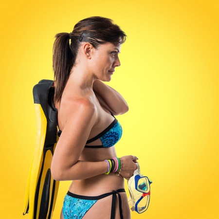 Girl in bikini with scuba fins Banque d'images