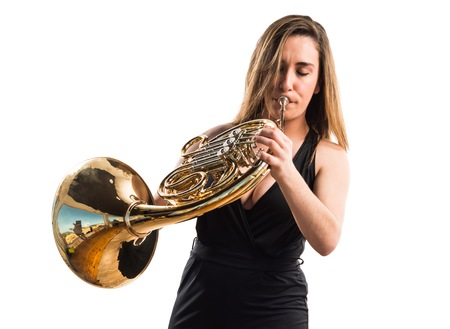 Girl playing the french horn Stock Photo