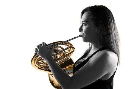 Girl playing the french horn Stockfoto